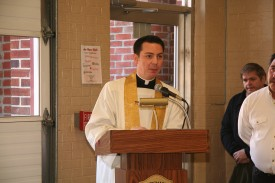 Father Christopher Monturo leads members and guests in prayer.