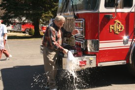 Ex Chief Ronald Mignone christens Engine 238.